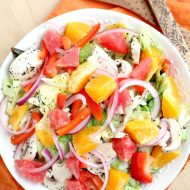 Sweet and Sour Citrus Salad recipe- citrus is the perfect fruit during wintertime. It has fresh vegetables, fruits, honey & poppy seed dressing. #fruit #salad #recipe #fruitsalad #healthy #meal #cleaneating #eatclean