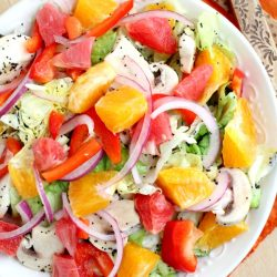 Sweet and Sour Citrus Salad recipe- citrus is the perfect fruit during wintertime. It has fresh vegetables, fruits, honey & poppy seed dressing.#fruit #salad #recipe #fruitsalad #healthy #meal #cleaneating #eatclean