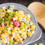 Corn Salad Sweet corn, tomatoes, peppers, onions, and jalapenos are tossed together with creamy mayo.