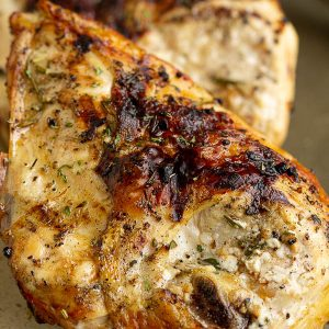 Super tender and juicy, Grilled Balsamic Chicken is deliciously rustic with a sweet and savory flavor! This will become one of your family favorites! #familyfavorite #grilled #chicken #chickenbreast #grilling #balsamic