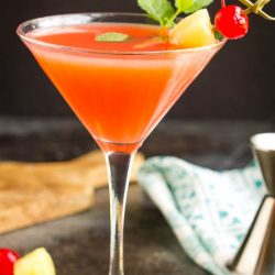 Sophisticated and beachy, Bikini Martini is the perfect summer cocktail combination with pineapple juice and coconut rum! This drink recipe is easy to make and goes down smoothly. #beach #cocktail #martini #recipe #rum #coconutrum #vodka #pineapplejuice