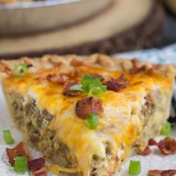 This Bacon and Sausage Quiche is perfect for lunch or dinner with a side salad and a glass of wine! It's creamy, cheesy and so delicious!A flavorful, savory addition to any brunch and a great way to use up leftover meat and veggies.