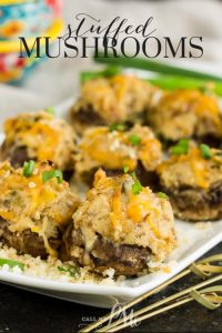 Stuffed Mushrooms are an easy make-ahead appetizer and are jam-packed with flavor from three kinds of cheese, herbs, and spices. #mushrooms #vegetarian #appetizer #recipe #creamcheese #breadcrumbs #makeahead #easy
