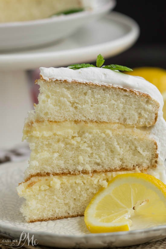 Recipe. Dessert. Lemon Cake is a tender white cake filled with tart lemon curd and covered with a fluffy whipped cream frosting.