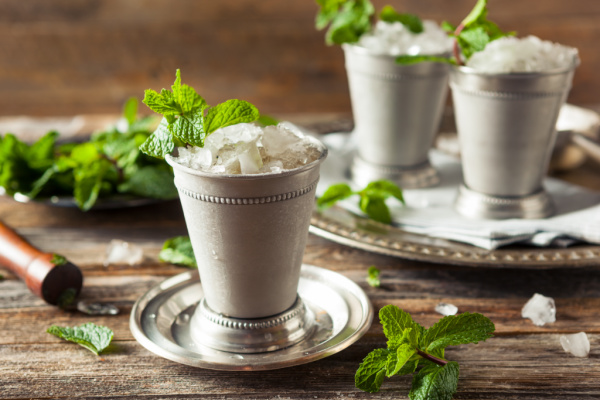 A classic ingredient mint julep cocktail made with bourbon, crushed mint, ice, and water and served in a silver julep cup. #mintjulep #KentuckyDerby #ChurchhillDowns #horserace #cocktail #bourbon #bourboncocktails #recipes #cocktailrecipes #callmepmc