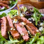Black and Blue Salad is a hearty entree salad recipe with a spice-rubbed, blackened steak, blue cheese crumbles, and balsamic salad dressing. #salad #steak #steaksalad #blackenedsteak #bluecheese #recipe #entree #dinner #dinnersalad #entreesalad