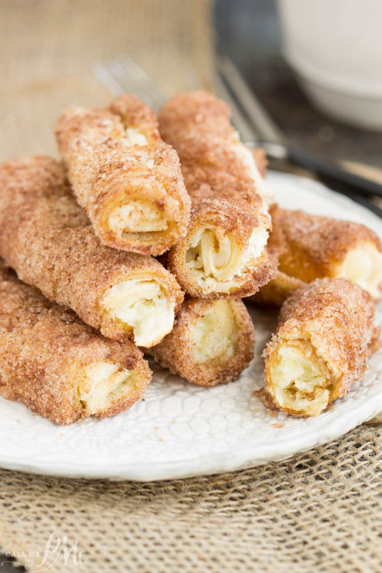 Cream Cheese Cinnamon Rollups -Sweet creamy filling rolled between layers of light crust with a light dusting of a cinnamon-sugar coating.