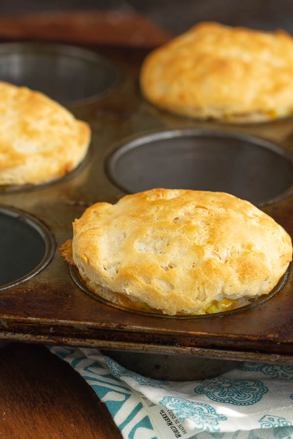 These Stuffed Biscuits are filled with sausage, egg, and cheese and make a delicious portable breakfast that kids love! It's simple and yummy comfort food!