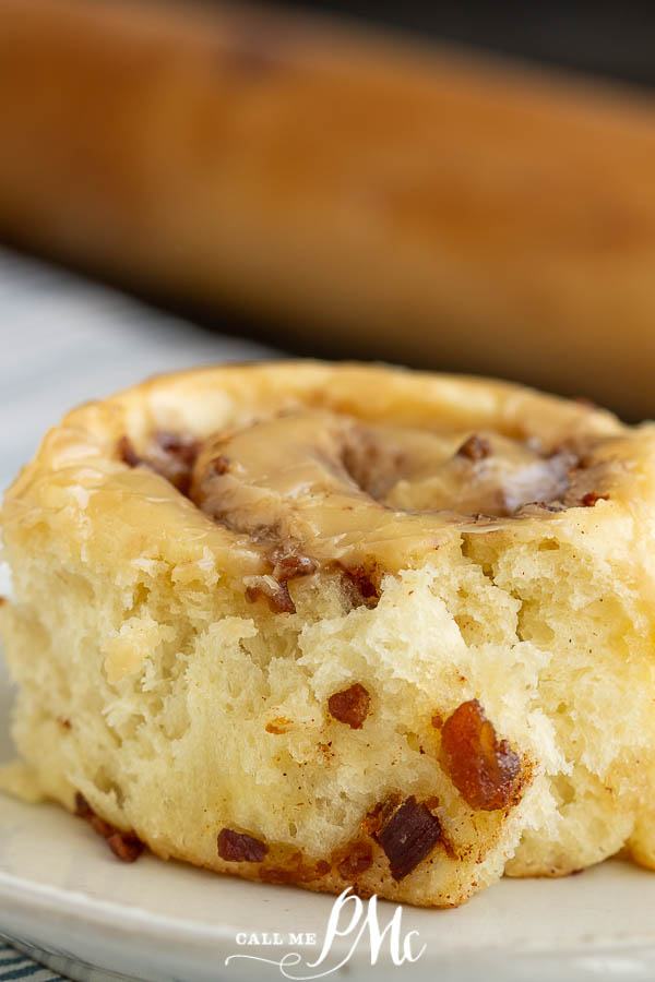 Bacon Breakfast Rolls with Maple Glaze recipe - soft, tender yeast dough is filled with bacon & smothered in maple frosting. #breakfast #cinnamonrolls #bacon #maple #recipe #yeastdough #callmepmc