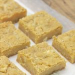 Lemon Cream Bars are Lusciously creamy and bursting with bright lemon flavor. Deliciously crumb bars start with a cookie mix and have a zesty lemon filling.