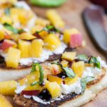 Sweet, Savory, Tangy, Crisp, and Creamy perfectly describes Peach Bruschetta. Slices of crusty, toasted baguette are topped with goat cheese, peaches, basil, and a drizzle of balsamic glaze.