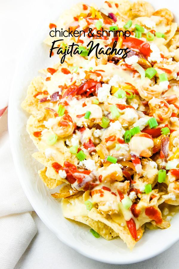 Chicken Shrimp Fajita Nachos are delicious when layered with all the good stuff chicken, shrimp, peppers, onions, and cheese. #chicken #shrimp #fajita #nachos via @pmctunejones