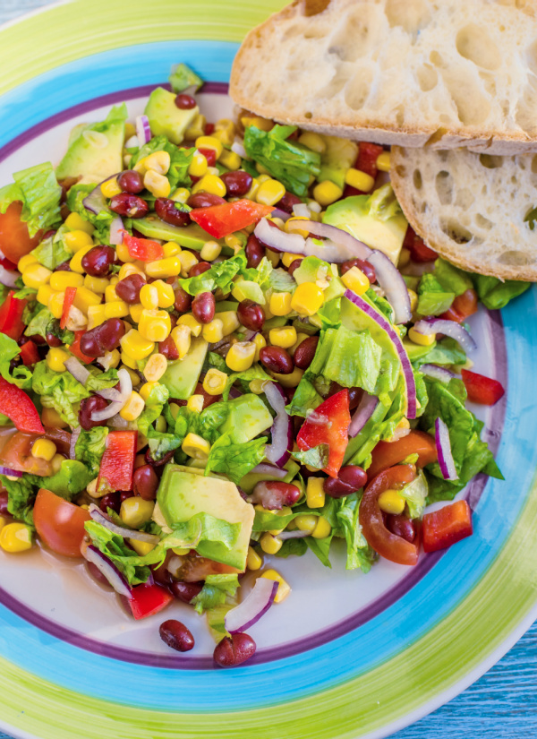 Fresh, colorful, and vibrant, Southwestern Salad with Green Chile Lime Salad Dressing has an incredible, bold flavor. It's the perfect salad to serve for Taco Tuesday!
