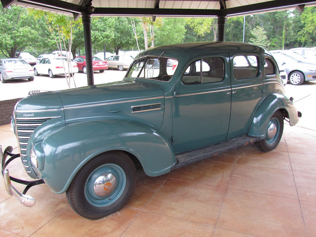 1939 green Plymouth sedan. It is parked northwest in the direction of Memphis.
