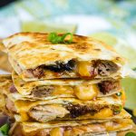 BBQ Pulled Pork Quesadilla, soft flour tortillas are filled with tender pulled smoked pork, spicy barbecue sauce, and gooey cheddar cheese.