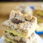 Peanut Butter Cookies and Cream Bars bake up like magic. They are so decadent and gooey you won't be able to stop eating them!  Layers and layers of my favorite candies.