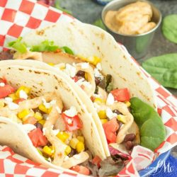 Southwest Chicken Wraps are full of nutrients and flavor. An easy recipe that starts with leftover chicken. Corn, black beans, lettuce, and tomato and a special sauce round out this delicious meal.