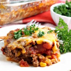 Tamale Pie recipe is quick and easy to make. A spicy beef mixture with Mexican flavors sits on top of creamy grits and replicates the familiar tamale taste an texture. #tamales #casserole #tamalepie #TexMex #recipe