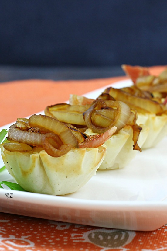Brie and Onion Bites - caramelized, sweet onions and creamy, warm brie fill pre-made crispy phyllo cups in this easy appetizer recipe!
