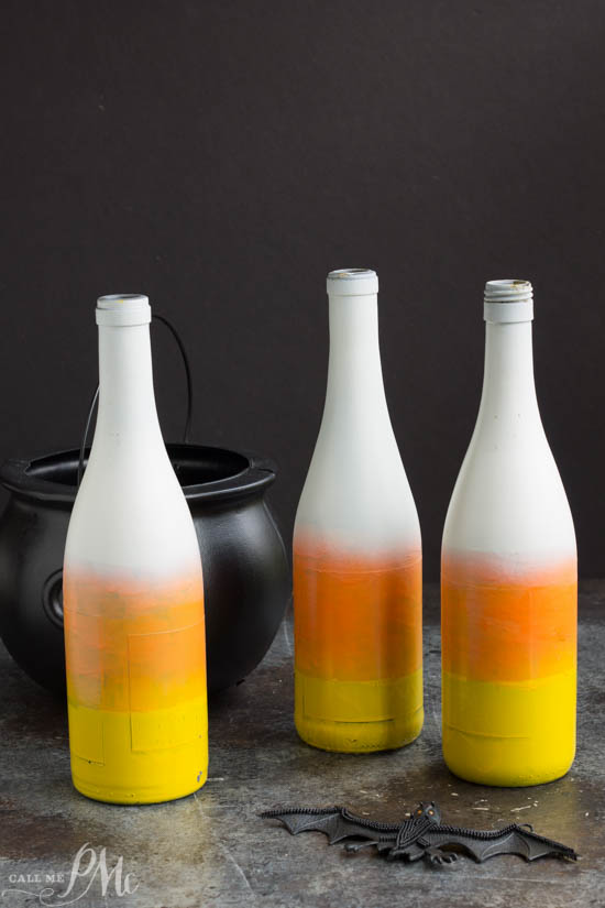 Candy Corn painted bottles make a cute fall table or yard decoration.