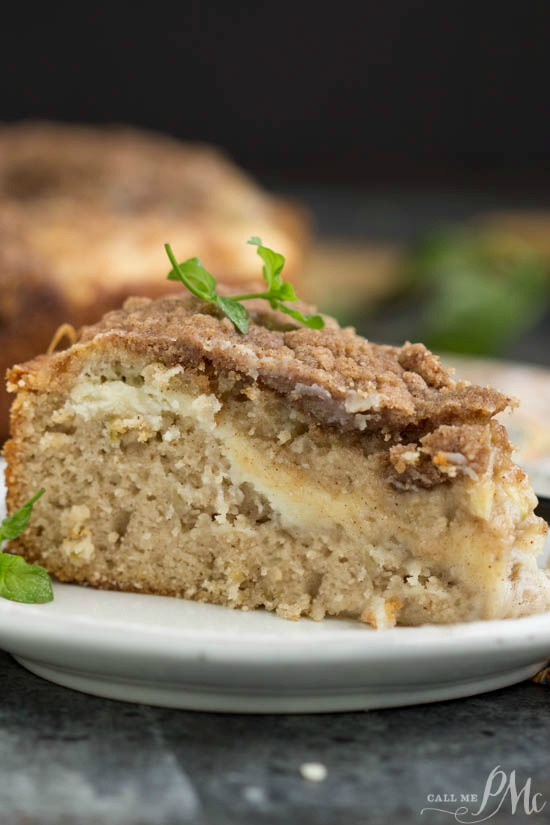 Apple Cinnamon Coffee Cake is a tender, spiced apple cake with a thread of cream cheese running through it and a nutty cinnamon pecan streusel sprinkled on top!