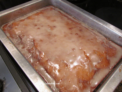 Apple Fritter Cake is moist and bursting with flavor. It's sweet, buttery and filled with caramel apples and cinnamon. Top it off with a sugary glaze and you have a cake that tastes just like an apple fritter! #easy #cake #Fall #fallrecipes #easycake #apple #applefritter #dessert #cinnamon