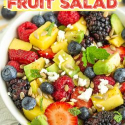 Avocado Fruit Salad with Cranberry Vinaigrette is packed with crunchy greens, bright berries, and creamy avocados.