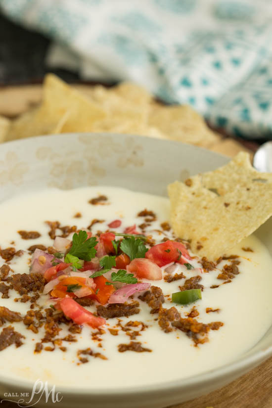 Taco meets cheese for a melty, cheesy, comfort situation in my Spicy Chorizo Queso! A fantastic, shareable, warm, cheesy dip that's easy to make and perfect for every party.