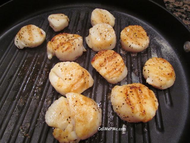 large scallops seared in a pan
