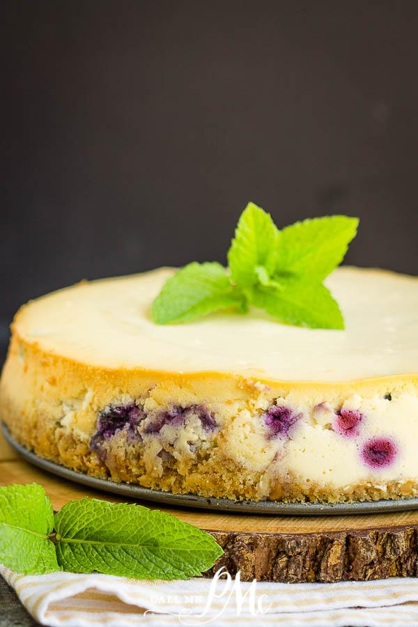 Best Blueberry Cheesecake Recipe (better than Starbucks) - vanilla wafer crust full of fresh fruit. Homemade recipe with detailed instructions #cheesecake #recipes #dessert #callmepmc #dessertrecipe #blueberry
