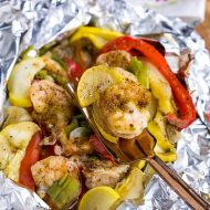 Delicious, healthy, and done in 30 minutes Shrimp Foil Packs in Oven are cooked in foil packets for a fuss-free weeknight meal and easy cleanup! #shrimp #foilpack #camping #campfire #grill #bake #oven #30minutemeal