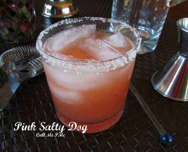 Grapefruit salty dog Cocktail with ice in glass on gray stone background