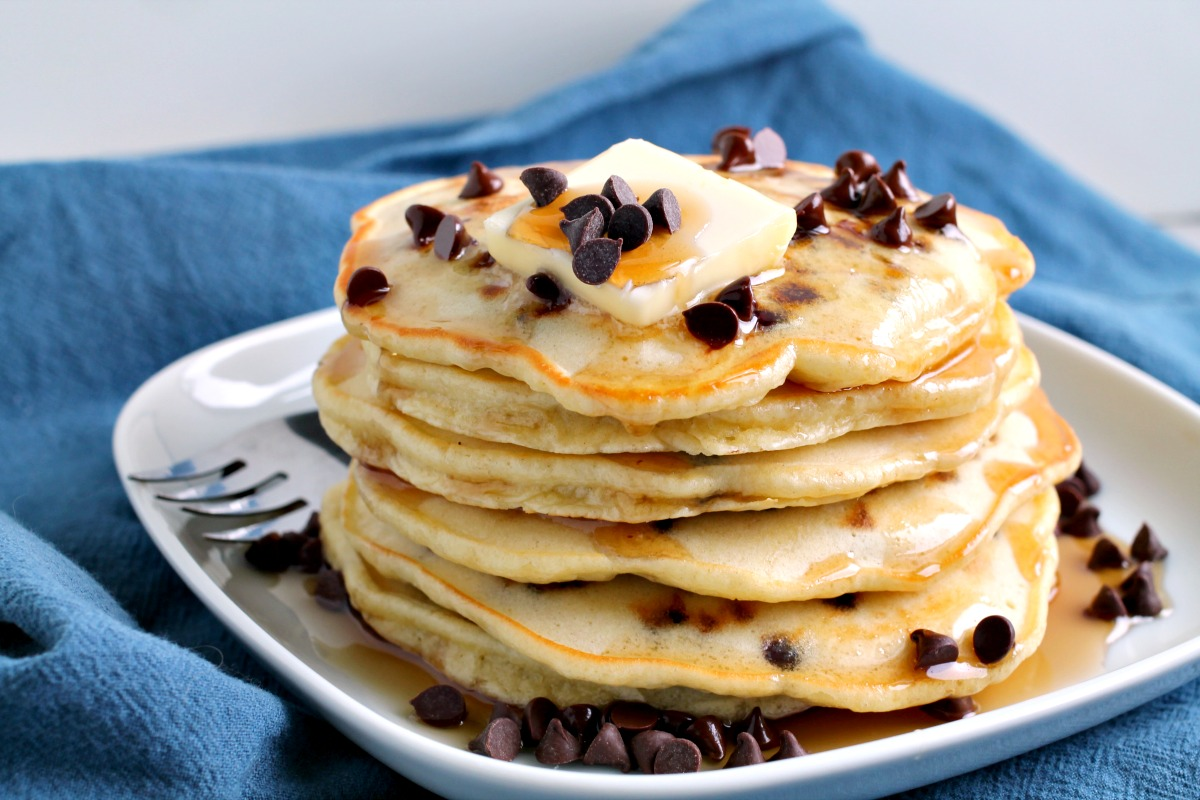 Light, fluffy, and super easy homemade Chocolate chip Pancakes are the most delicious breakfast treat. #pancakes #breakfast #recipe #homemade #fromscratch #chocolatechip