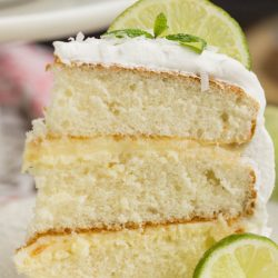 Lime & Coconut Icebox Cake with Fresh Whipped Cream recipe combines the ever popular Icebox Pie with a layer cake. This dessert is cool and refreshing. Spiked with tropical flavors of citrus and coconut this makes a tasty hot weather dessert.