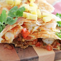 This easy Shrimp Quesadilla Recipe is perfect for a quick dinner, snack, or game day treat. They are super easy to make and done in less than 15 minutes.