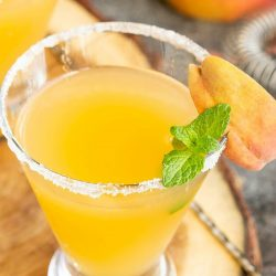 Peach Bellini Martini with vodka, peach schnapps, and peach nectar makes the perfect refreshing cocktail for a warm afternoon or a fancy brunch.