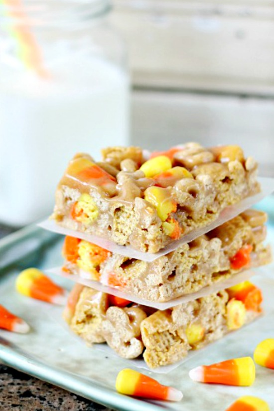 15 Minute Cereal Bars are you no cook answer to snacking. Inspiration came from traditional Rice Krispie Treats  for this recipe but gets a Halloween spin with fun candy corn candies. 15 Minute Cereal Bars, literally, 15 minutes until snack time!