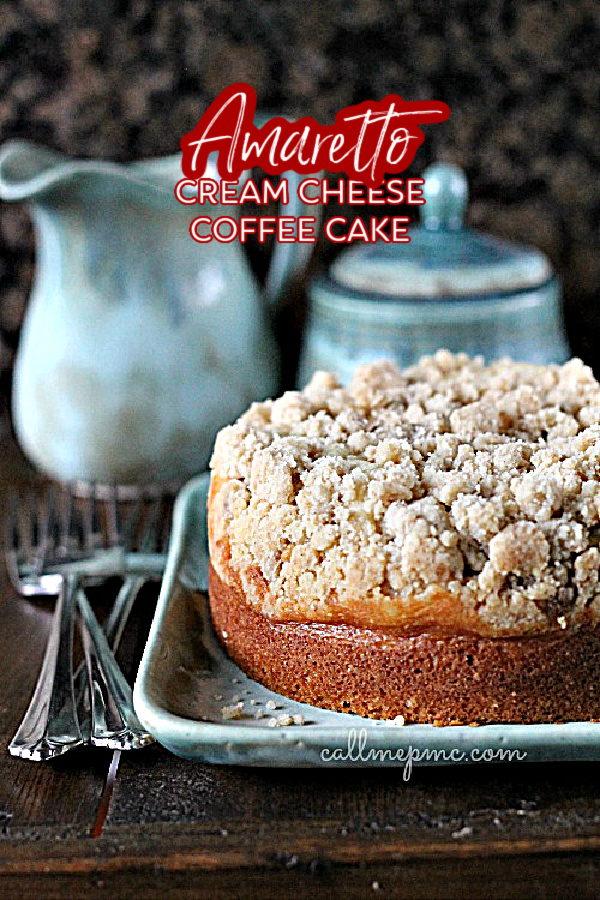 Amaretto Cream Cheese Coffee Cake Recipe is a sweet, dense coffee cake topped with an extra crumb topping and filled with a ribbon of cream cheese. #coffeecake #cake #streusel #creamcheese #baking #baked #homemade #recipe via @pmctunejones