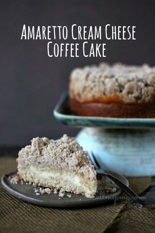 Amaretto Cream Cheese Coffee Cake Recipe is a sweet, dense coffee cake topped with extra crumb topping and filled with a ribbon of cream cheese.