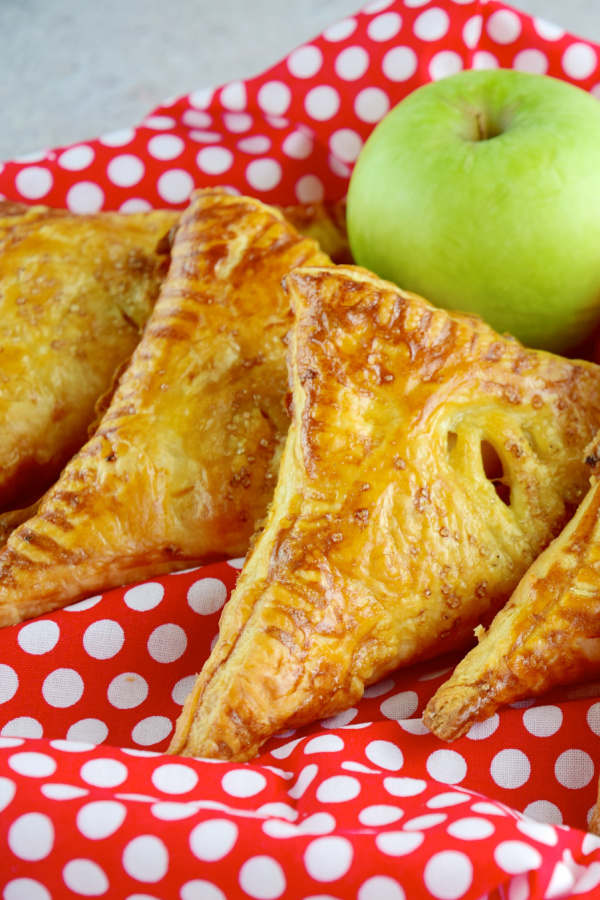 Easy Apple Turnovers are light, flaky & filled with apple cinnamon goodness!
