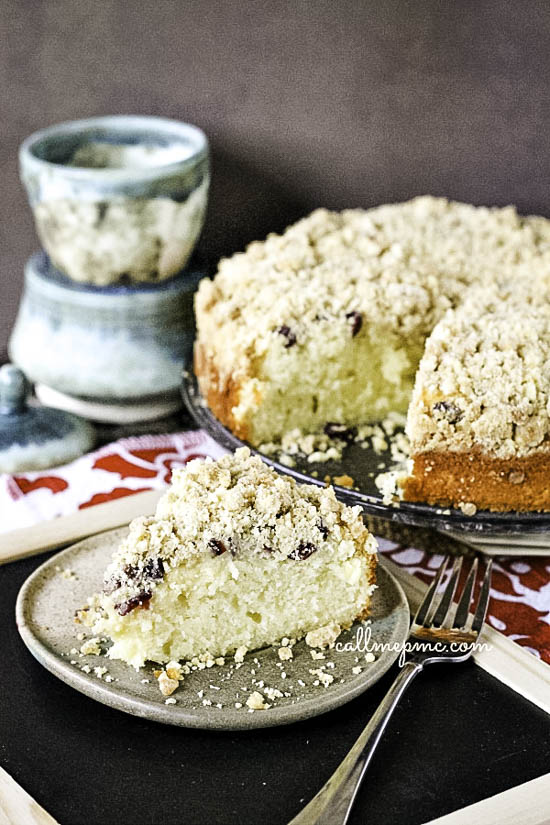 Best coffee cake ever!! Cranberry Eggnog Crumb Coffee Cake has so much flavor, is super moist, and that crumb topping is everything! A tender eggnog, vanilla cake is filled with cranberries and topped with a buttery crumb topping. A delicious treat for breakfast or dessert.