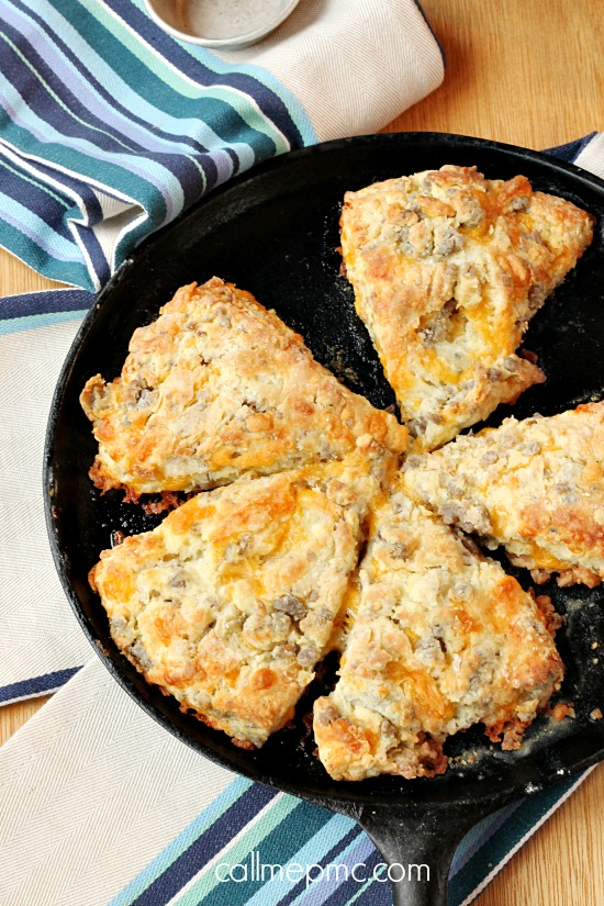 Cheddar cheese and spicy sausage are combined with Greek yogurt in these flaky, buttery and decadent Sausage Cheese Scones. #breakfast #bread #cheese #sausage