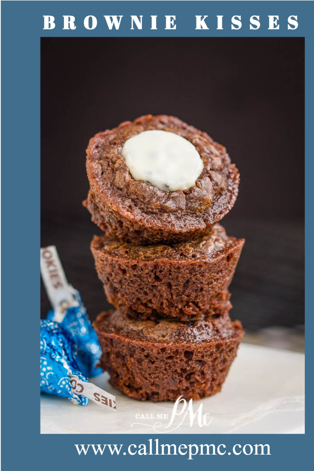 Brownie Kisses are rich, decadent chocolate fudge bites made more special crowned with cookies and cream chocolate Kiss while they're still hot and gooey. #brownies #recipes #cupcakes #cake #chocolate