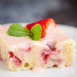 Fresh Strawberry Yogurt Cake is a beautiful, deliciously moist, and flavorful sheet pan cake. #cake #strawberrycake #recipe #sheetpan #dessert