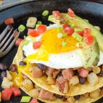 Huevos Rancheros Breakfast Stack packs a tasty punch for breakfast. Hearty and filling, this classic Mexican feast is kicked up with non-traditional ingredients. #eggs #breakfast #recipe #TexMex #HuevosRancheros