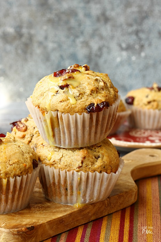 Moist and full of fall flavors, these Dried Cranberry Orange Muffins are full of tart cranberries, zesty orange, and toasted pecans. #muffins #breakfast #recipe #healthy via @pmctunejones