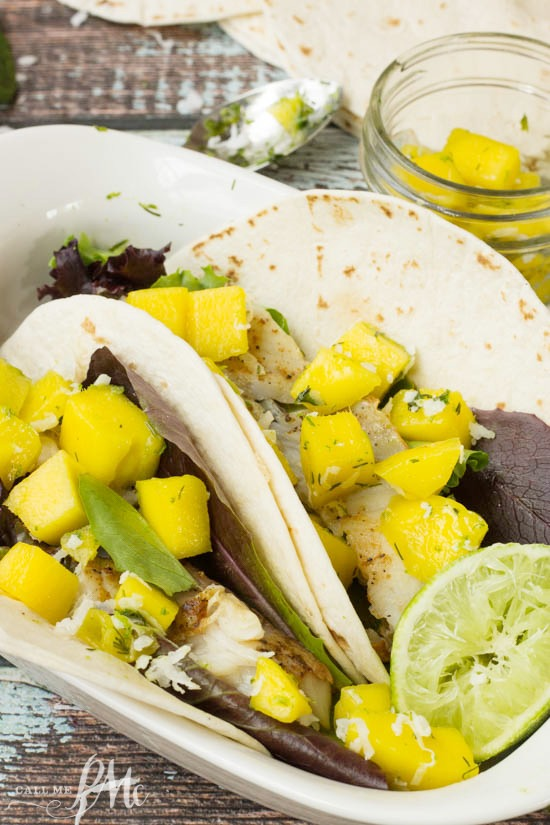 Bright and fresh, Fish Tacos with Mango Coconut Lime Salsa is an easy weekday dinner that you can have ready in less than 30 minutes!