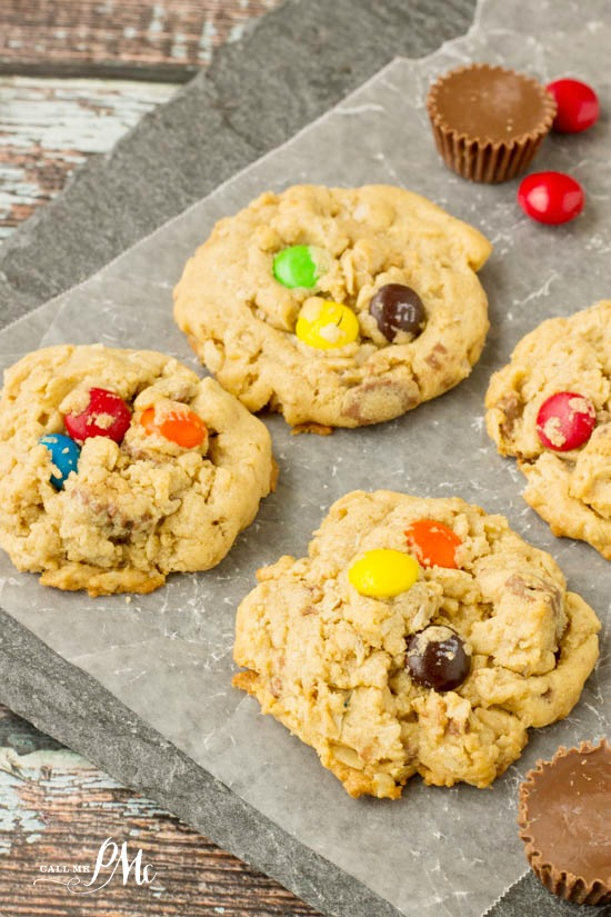 Soft Peanut Butter Oatmeal Cookie Recipe is full of peanut butter, oats, M&Ms, and Reese's peanut butter cups. Yes, it's chocolate, chocolate, and more chocolate! #cookies #candy #chocoalte #oats #recipe via @pmctunejones