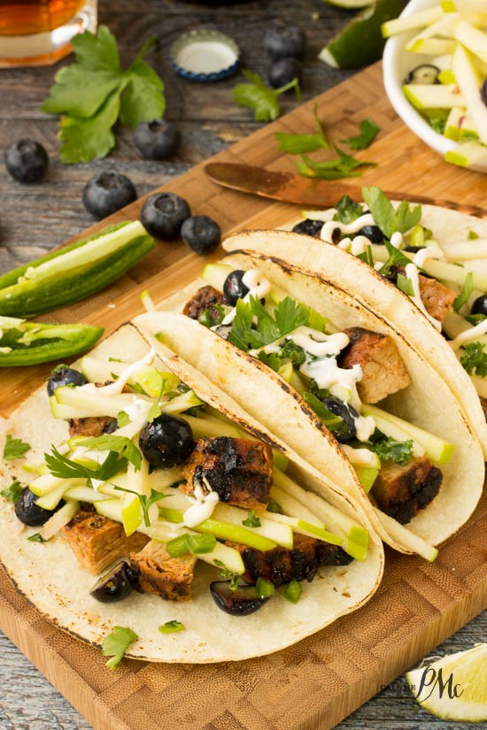 Apple Slaw Pork Loin Tacos are full of tender pork loin, crunchy apple slaw spiked with juicy blueberries wrapped in warm, soft tortillas. #pork #tacos #tortillas #texmex #recipes via @pmctunejones