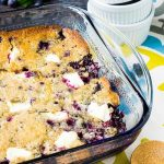Blueberry Cream Cheese Dump Cake has got to be the easiest cake in the world to make. Fresh blueberries sit on the bottom with chunks of cream cheese scattered throughout.